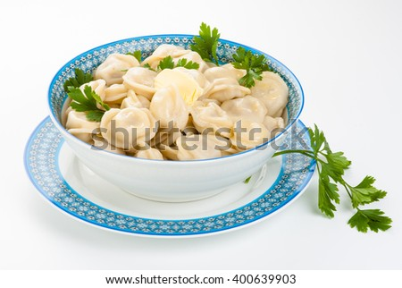 dumplings in a plate with a parsley and butter - stock photo