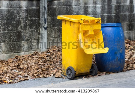 dumpster filled with household waste - stock photo
