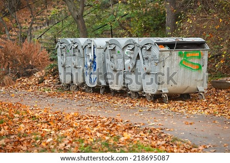 Dumpsters by the walking path - stock photo