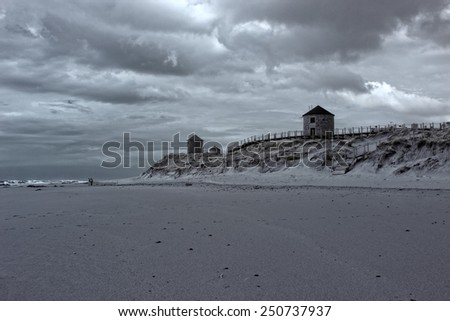 Dune and empty beach from the north of Portugal. Infrared toned blue.  - stock photo