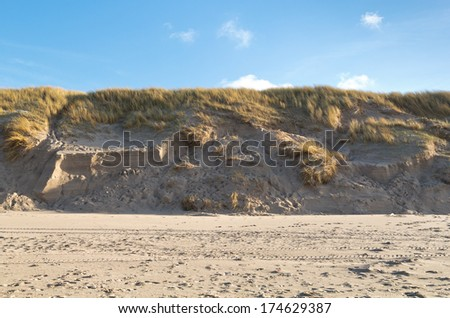 Dunes on the Dutch coast seen from the beach. - stock photo