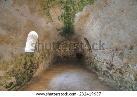 Dungeon were male slaves were kept prior to transshipment. Elmina Castle is a UNESCO World Heritage Site located on the Atlantic coast of Ghana, west of the capital, Accra. - stock photo