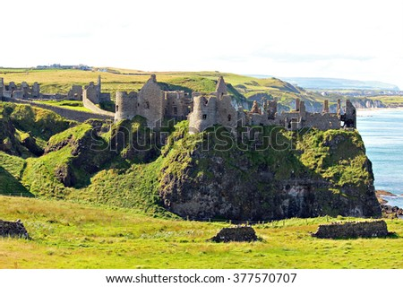 Dunluce Castle, Northern Ireland, at the edge of a cliff. - stock photo