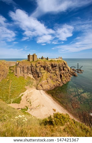 Dunnottar Castle, Aberdeenshire, Scotland is a ruined medieval cliff-top fortress dating to the fourteenth century with historic connections to Mary Queen of Scots, James 6th and Oliver Cromwell. - stock photo