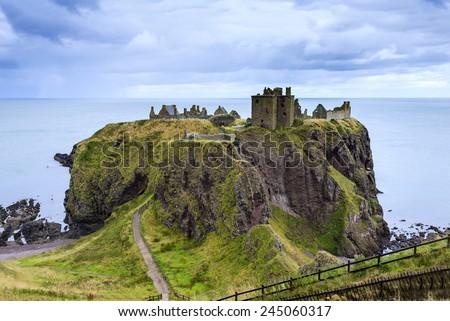 Dunnottar Castle ruins, Scotland - Dunnottar is a ruined medieval fortress located upon a rocky headland on the north-east coast of Scotland, about 3 kilometres (1.9 mi) south of Stonehaven.  - stock photo