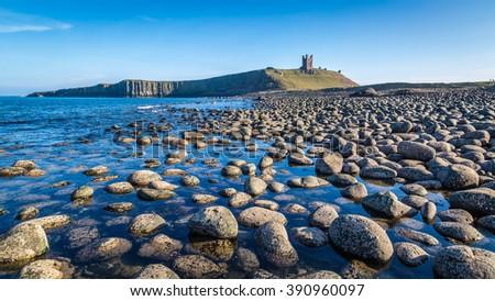 Dunstanburgh Castle on the Northumberland Coastline, England - stock photo