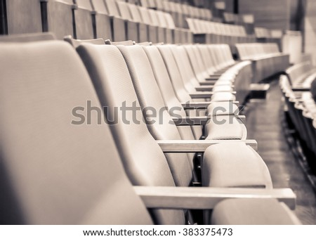Duo tone color image/ Close up and selective focus of Empty rows of armchairs in hall  - stock photo