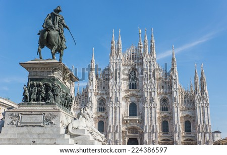 duomo cathedral and Vittorio emanuele statue - stock photo