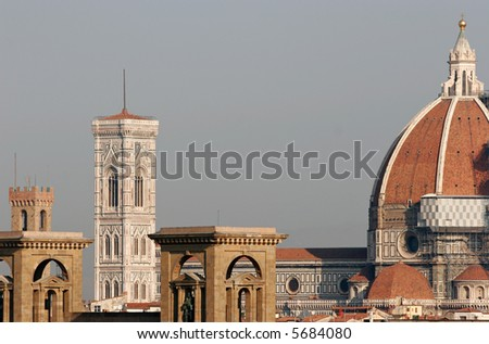 Duomo cathedral protruding over the rooftops of Florence. Taken in early morning. - stock photo