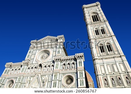 Duomo Firence over blue sky. Facade and campanile of Duomo in Florence, Italy.  - stock photo