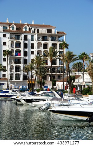 DUQUESA, SPAIN - JULY 18, 2008 - Yachts and boats in the marina surrounded by apartments and restaurants, Puerto Duquesa, Malaga Province, Andalucia, Spain, Western Europe, July 18, 2008. - stock photo