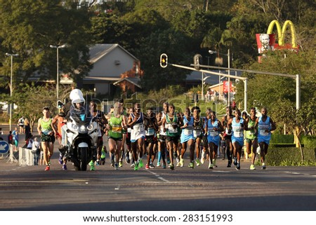 DURBAN, SOUTH AFRICA â?? MAY 31: Group of men run through Hillcrest, Gift Kelehe goes on to win the 2015 Comrades marathon up run for South Africa in Kwa Zulu Natal, South Africa on May 31, 2015.  - stock photo