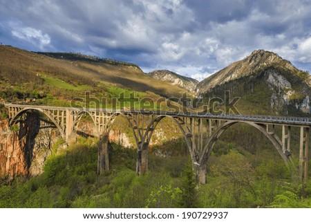 Durdevica Tara concrete arc bridge in the mountains, North of Montenegro. - stock photo