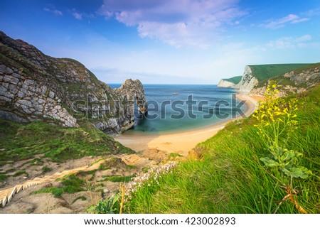 Durdle Door at the beach on the Jurassic Coast of Dorset, UK - stock photo
