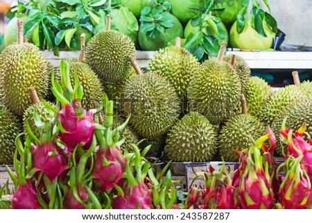 Durian and pitahaya in the street market  - stock photo
