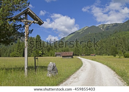 During the ascent to Enningalm in the Ammergau Alps the walkers will pass on this glorious alpine pastures - stock photo