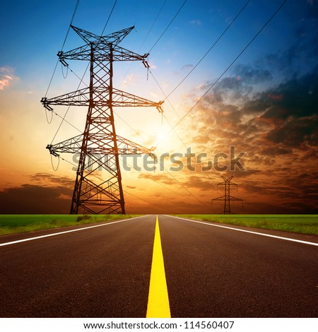 Dusk, highways and high-voltage tower. - stock photo