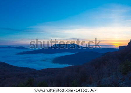 dusk in a mountains - stock photo
