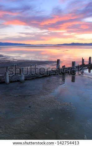 Dusk landscape with old relics at the Great Salt Lake, Utah, USA. - stock photo
