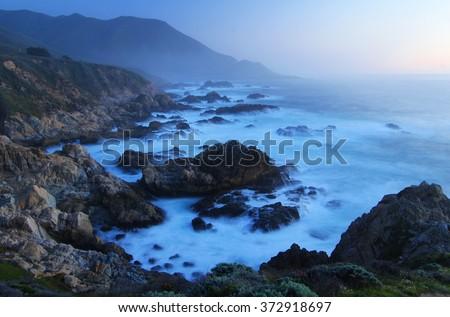 Dusk light over Big Sur, near Monterey, California - stock photo