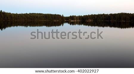 Dusk on Sunbeam Lake in Algonquin Provincial Park, Ontario, Canada.  - stock photo