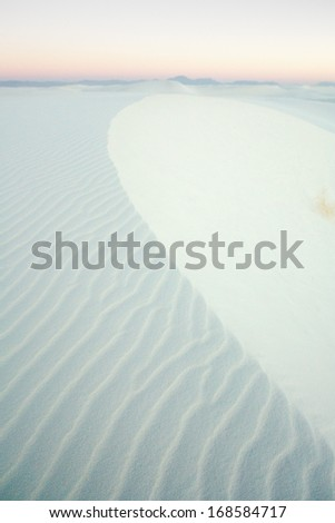 Dusk over gypsum sand dune shapes in White Sands National Monument, New Mexico - stock photo