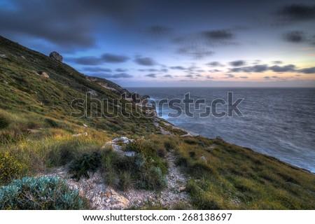 Dusk over the Mediterranean sea in Bahrija, Malta - stock photo