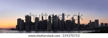 Dusk panorama of a Downtown Manhattan silhouette in New York City  - stock photo