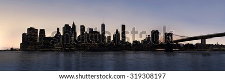 Dusk panorama of New York City Manhattan and Brooklyn Bridge, view from Green point pier - stock photo