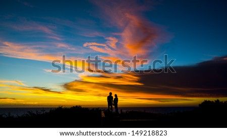 Dusk, people silhouettes - stock photo
