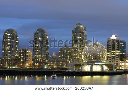 Dusk settles over Vancouver Science World. Shot from Cambie Street Bridge. - stock photo