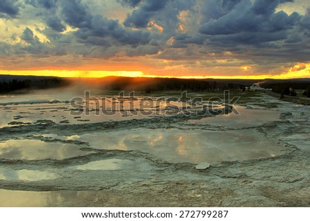 Dusk sky above a geyser in Yellowstone, Wyoming, USA. - stock photo