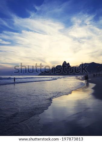 Dusk sunset reflection of Rio de Janeiro Ipanema Beach Brazil with Two Brothers Mountain - stock photo