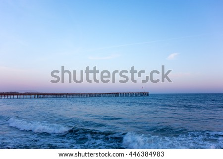 Dusk time slowly rolling into the night above historic Ventura wooden pier, California - stock photo