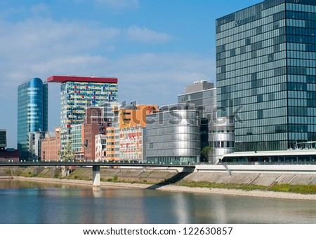 DUSSELDORF - AUGUST 11: Media Harbor on august 11, 2012 in Dusseldorf. As important harbor it already has lost its glory but nowadays the area itself contains some spectacular post-modern architecture - stock photo