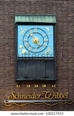 Dusseldorf, Chiming clock with dedicated to Schneider Wibbel - character of urban story, Germany - stock photo