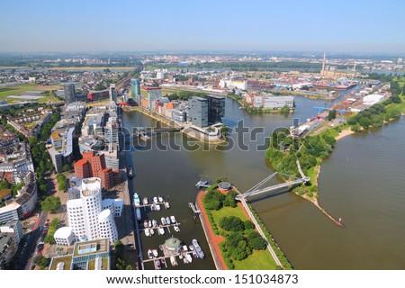 Dusseldorf - city in North Rhine-Westphalia region of Germany. Part of Ruhr region. Aerial view with Hafen (seaport) district on Rhine river. - stock photo