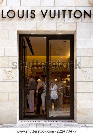 Dusseldorf, Germany - August 20, 2011: Louis Vuitton store on Koenigsallee. Louis Vuitton Malletier is a french fashion house founded in 1854, today belonging to LVMH group. - stock photo