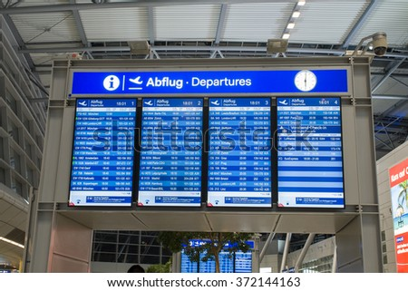 Dusseldorf, Germany- February 4, 2016: Display screen of departures at Dusseldorf International Airport. Dusseldorf Airport located in North Rhine Westphalia and is the 3 largest Airport in Germany. - stock photo