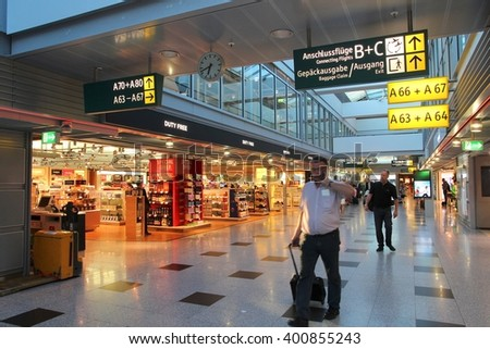 DUSSELDORF, GERMANY - JULY 8, 2013: Travelers visit duty free shop in Dusseldorf Airport, Germany. With almost 21 million annual passengers it is the 3rd busiest airport in Germany. - stock photo