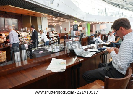 DUSSELDORF- SEP 16: Starbucks cafe interior in airport on September 16, 2014 in Dusseldorf, Germany. International airport of Dusseldorf located approximately 7 kilometres north of downtown Dusseldorf - stock photo