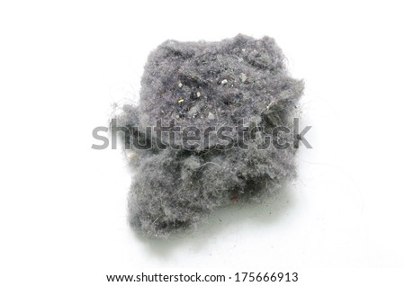 Dust bunny over a white background. House cleaning concept - stock photo
