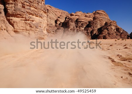 dust on road at a valley - stock photo