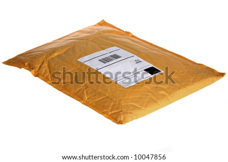 Dusty Old Mail Package Isolated - stock photo
