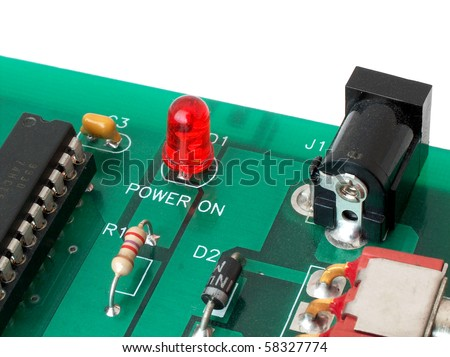 Dusty printed circuit board with some components soldered in. - stock photo