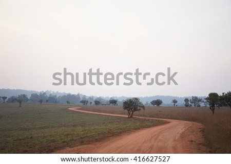 Dusty Road with Tire Track - stock photo
