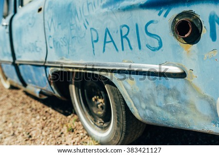Dusty texts car body details on vintage car in car cemetery - stock photo