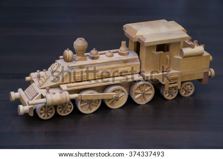Dusty wooden train - stock photo