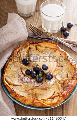 Dutch baby pancake with apple and cinnamon and fresh blueberry - stock photo