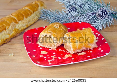 Dutch banket pastry with frosty pine on wood - stock photo